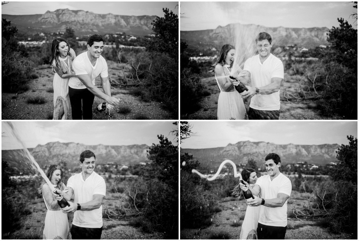 Summer Sedona Engagement Photos Popping Champagne with Sedona Red Rock Mountains in the background.