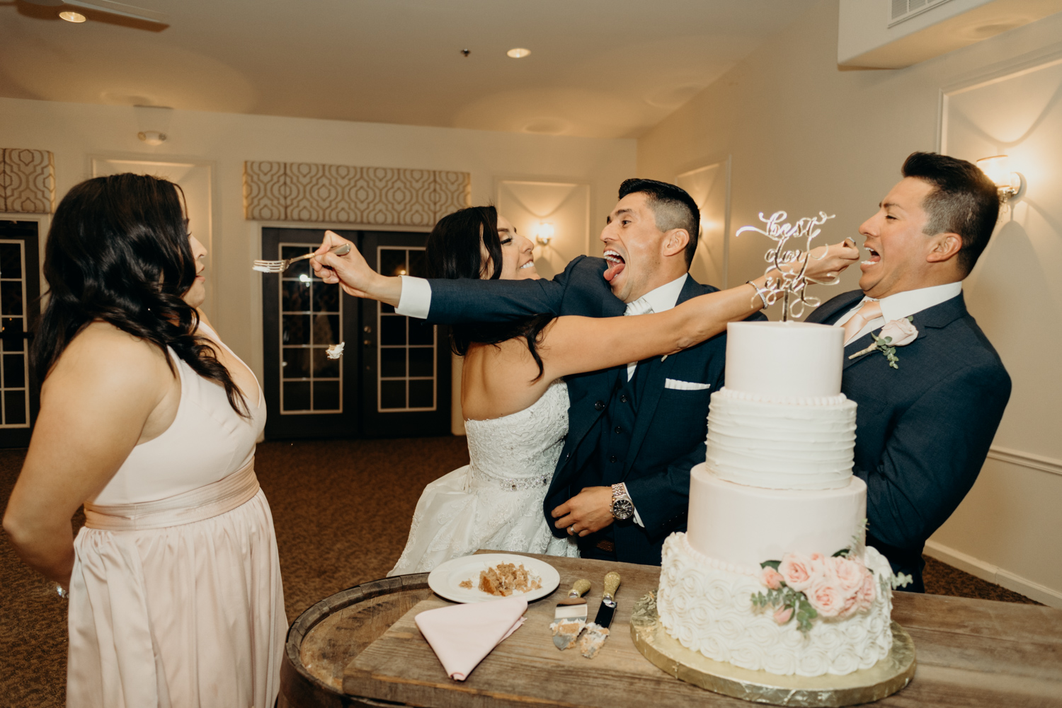 Couple cutting their wedding cake during their reception at Venue at the Grove in Phoenix, Arizona.