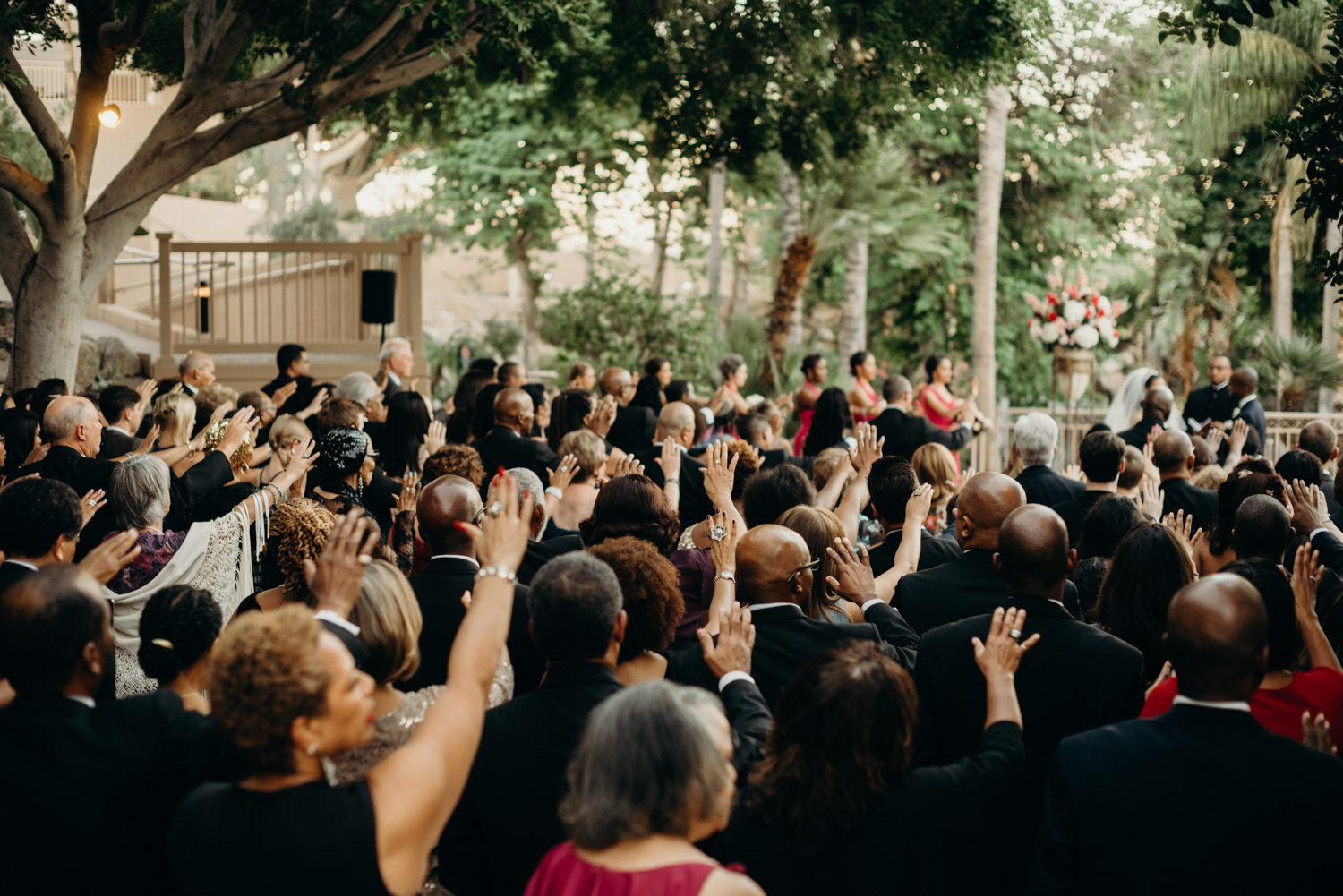 All the guest pray over the couple during their ceremony at the Phoenician Hotel in Arizona.