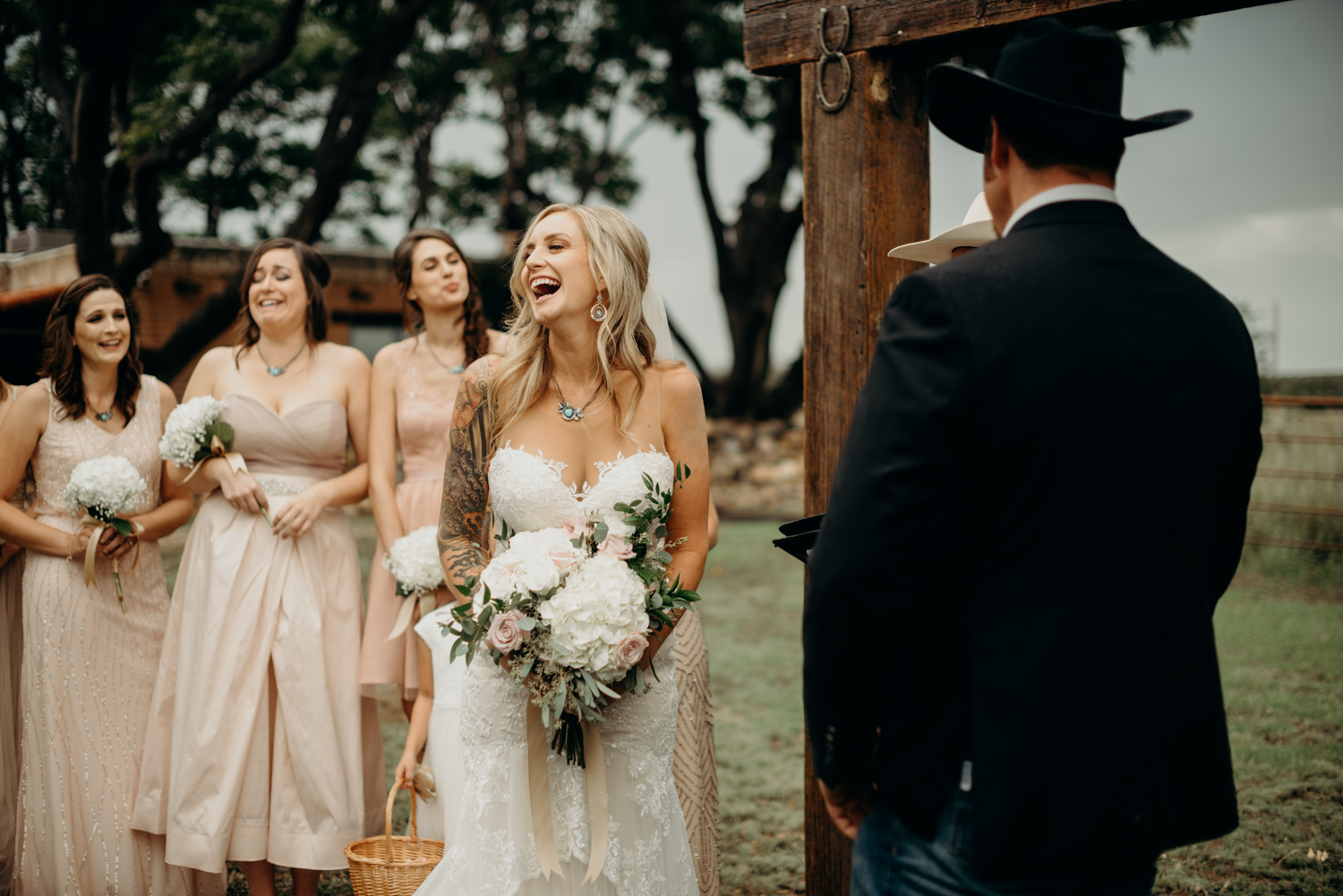 Genuine moment photographed of the bride during her outdoor ceremony at the Groom's family ranch in Arizona.