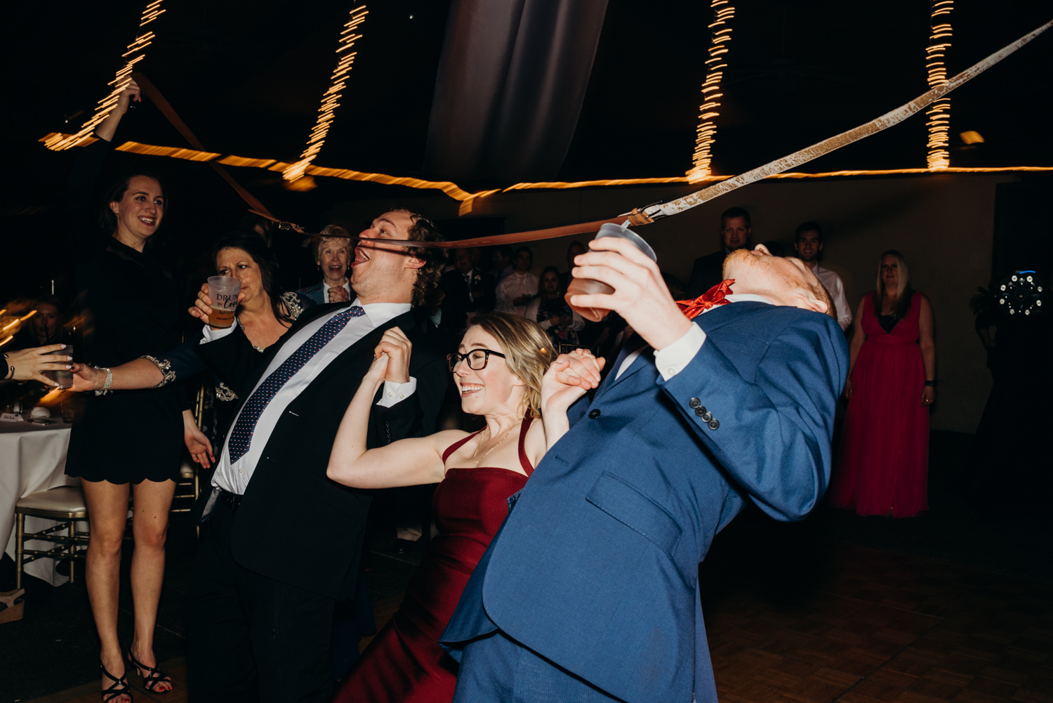 Guests do the limbo during the reception at McCormick Ranch Golf Club in Scottsdale, Arizona.