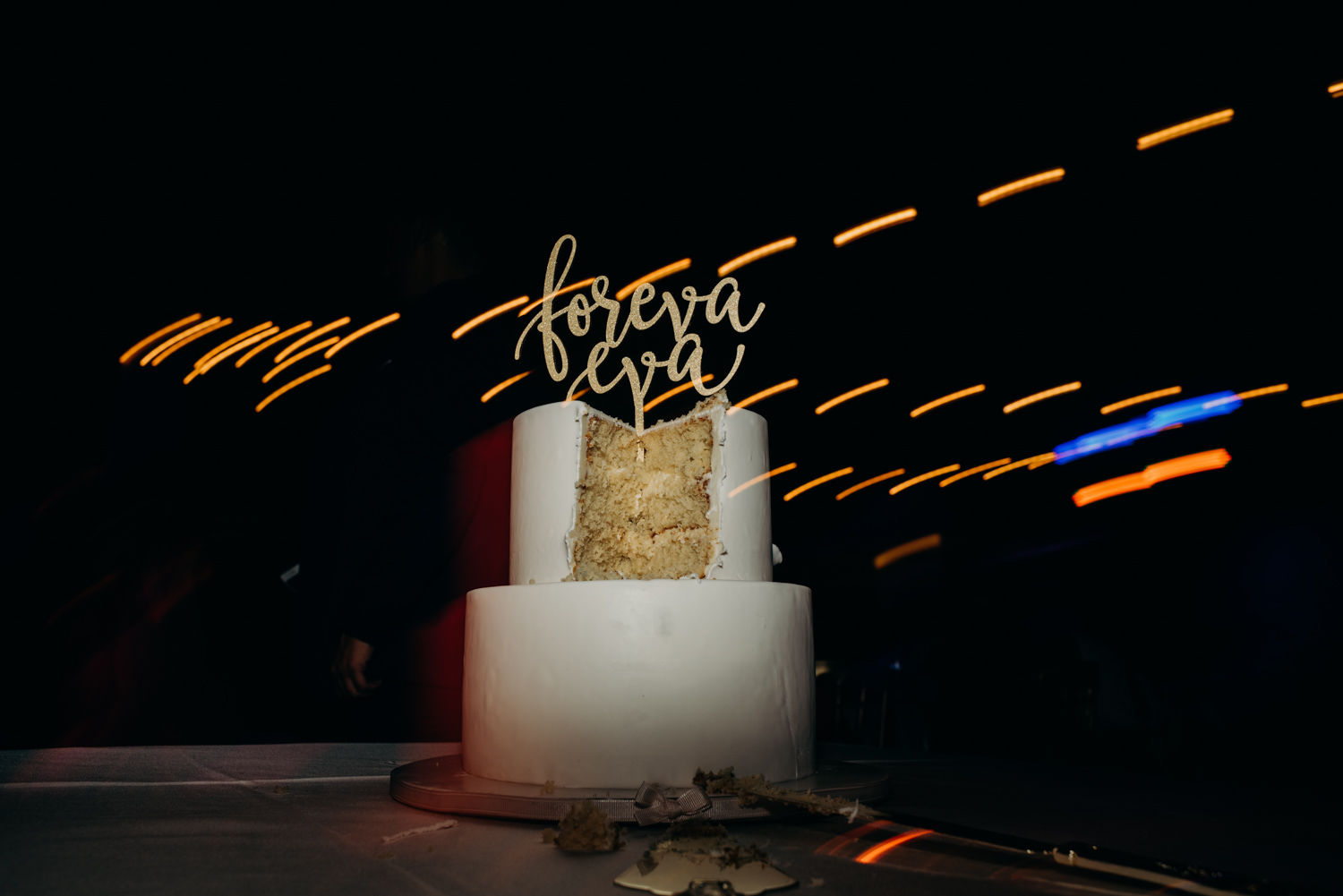 The wedding cake photographed after the couple cut into it during their reception at the Omni Hotel in Cancun, Mexico.