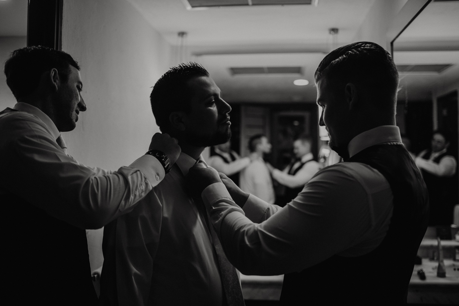 Real moments photographed during the Groom's getting ready in Cancun, Mexico.