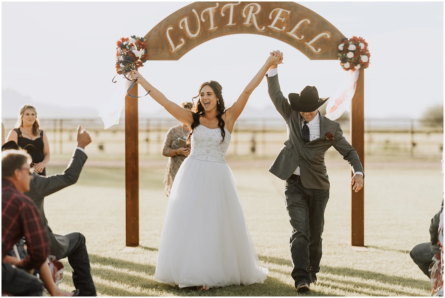 Bride and groom celebrate after getting announced husband and wife.