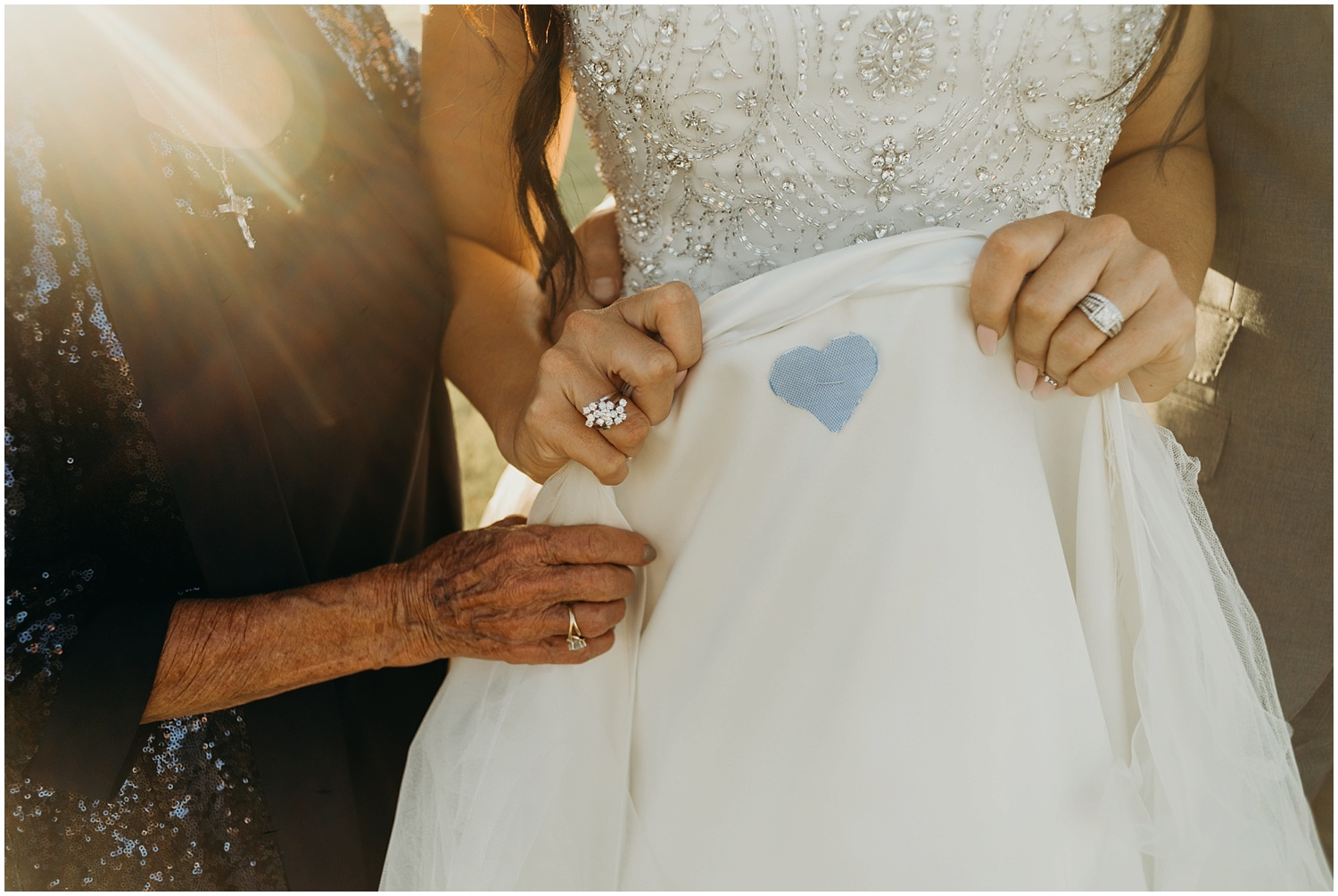 Bride's something blue pinned onto her wedding dress.