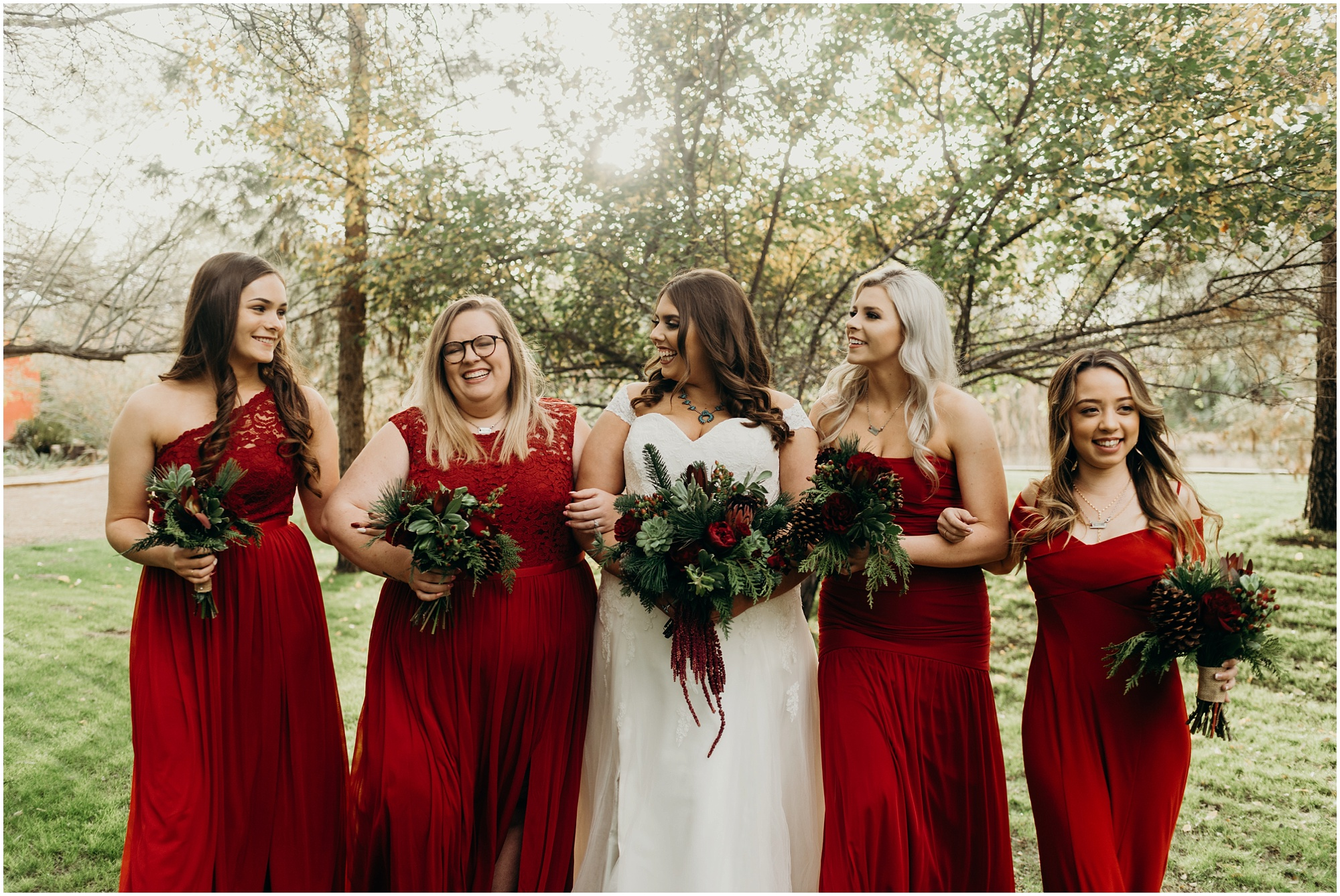 Candid and fun bridesmaids photos with red bridesmaids dresses for a Christmas Wedding.