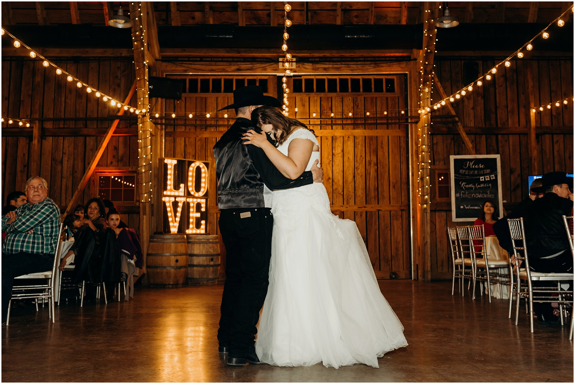 Intimate first dance photo from the couples Country Christmas Wedding Reception in a barn.