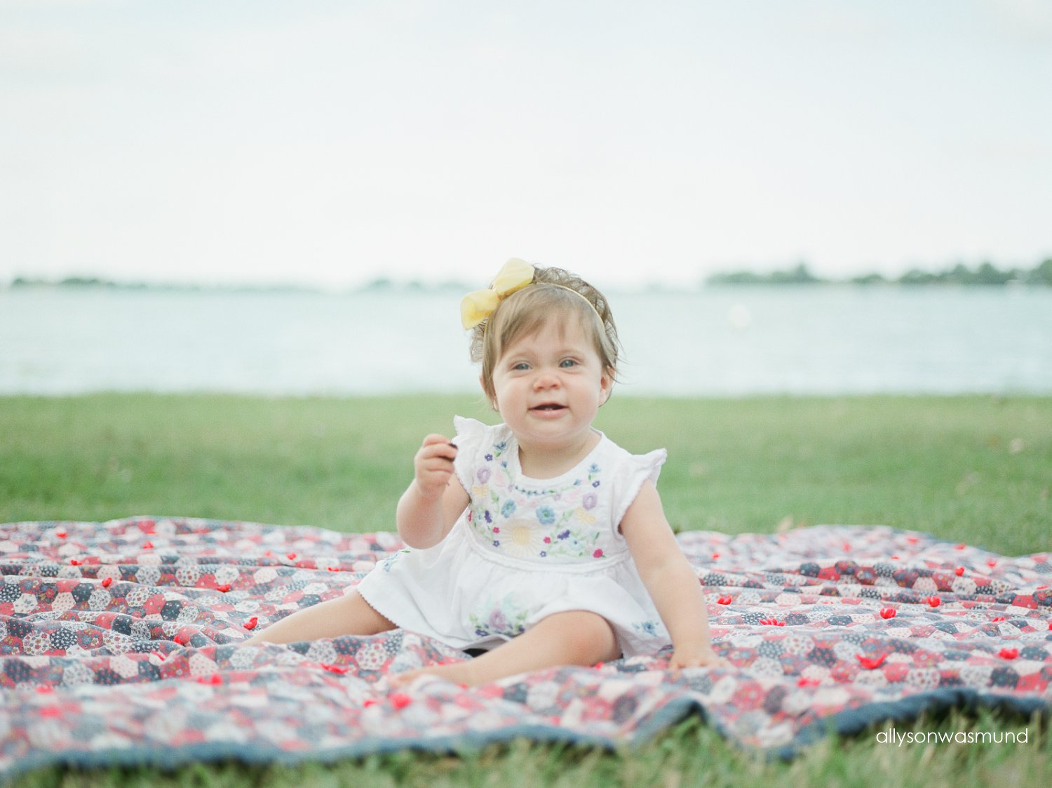 Baby Irelyn sitting on a blanket at her baby milestone film session.