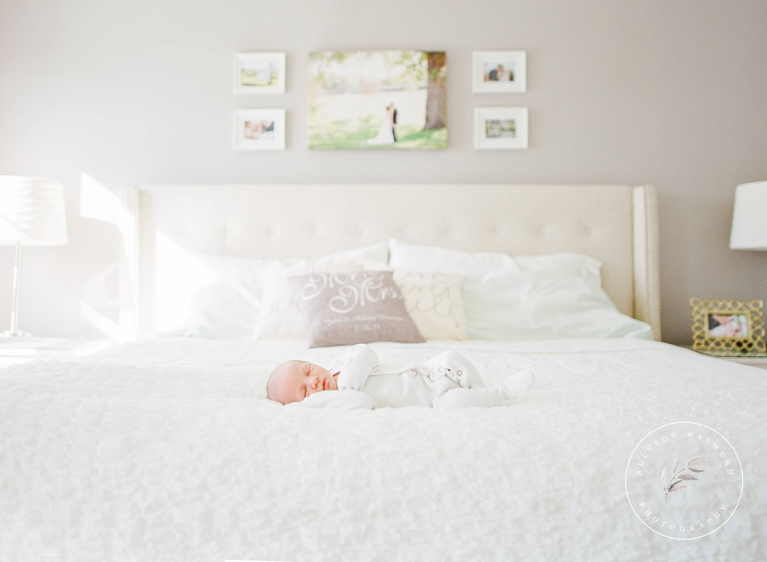 Newborn baby Jacob lays sleeping on his parents bed during their in-home newborn session in Maple Grove, Minnesota with Allyson Wasmund Photography.
