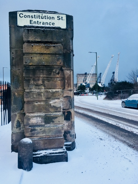 street entrance and dock cranes in snow.jpg