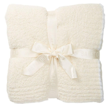 Barefoot Dreams Contrast Trim Throw (Amazon) - $99.99   What's winter without a cozy throw? I am a big fan of Barefoot Dreams for their softness, stretch and washability (I even have a larger version of this one on my couch now…received as a gift).