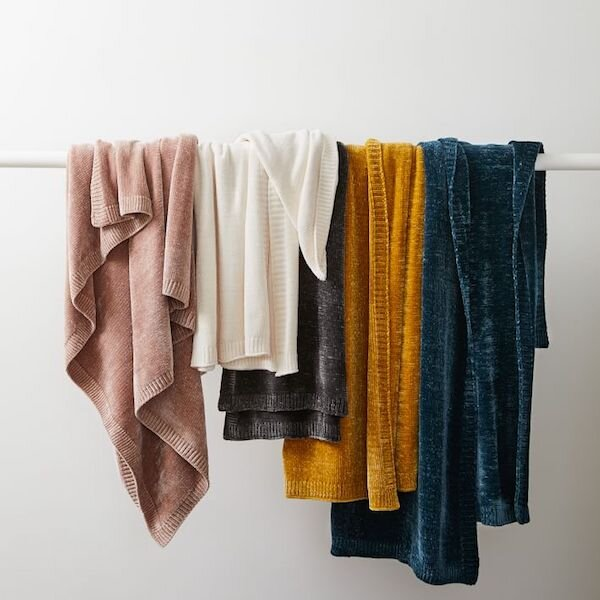Luxe Chenille Throws (West Elm) — $89   Who doesn't love to cozy up on the couch with a soft blanket and a warm drink on a fall day? Chenille is so soft and will look as good tossed across your sofa as it feels wrapped around your shoulders. Bonus points for non-traditional fall colors!