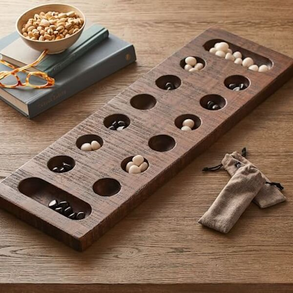 Wooden Mancala Game (Pottery Barn) — $99   When the weather turns cooler, what better way to spend an evening than games with friends. Mancala is a game I loved as a kid and this version is a beautiful decorative accent for your coffee table and a great way to have some fun with your family and friends on the fly.