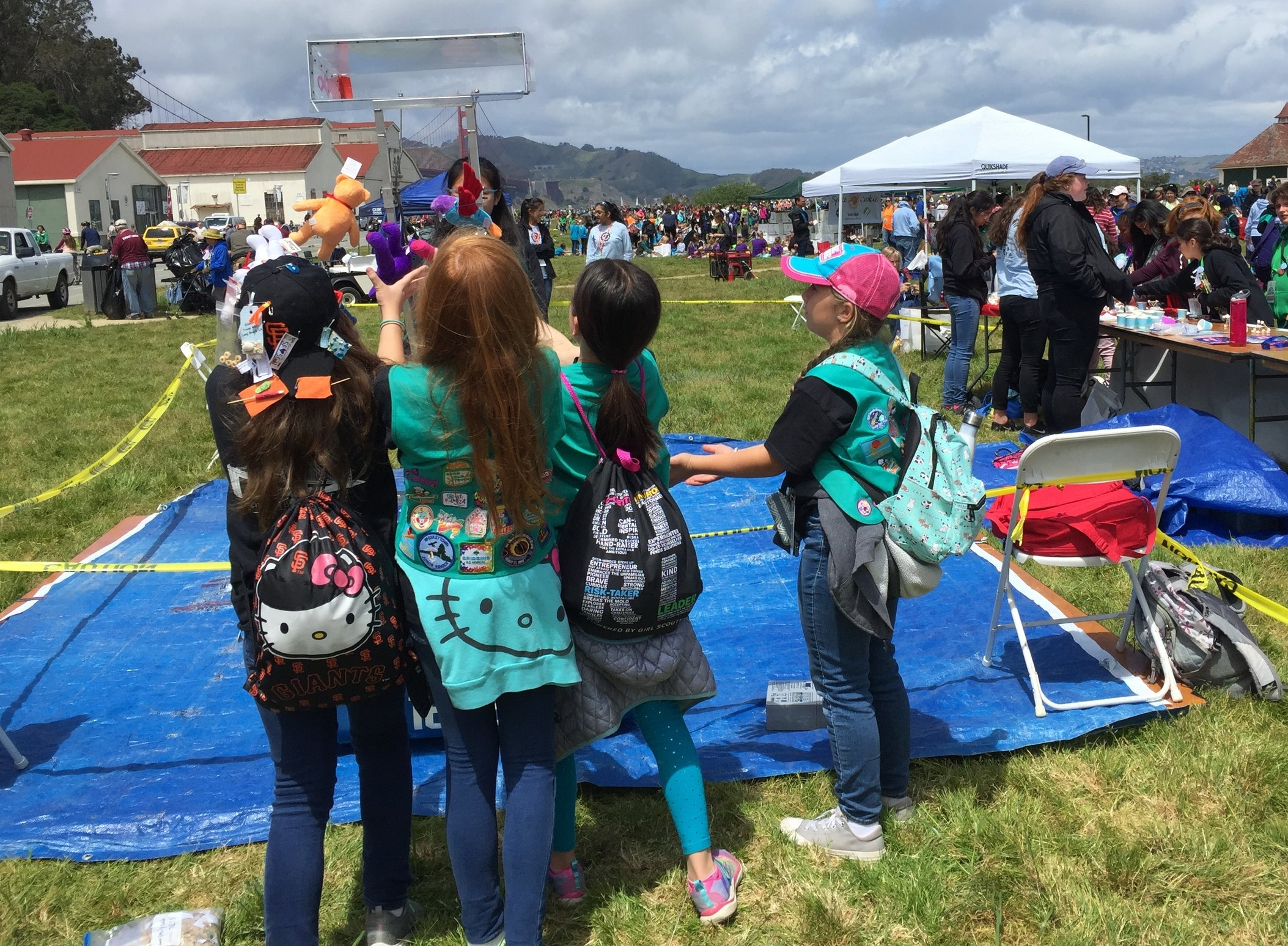 Space Cookies show younger girls how to drive the robot at Golden Gate Bridging