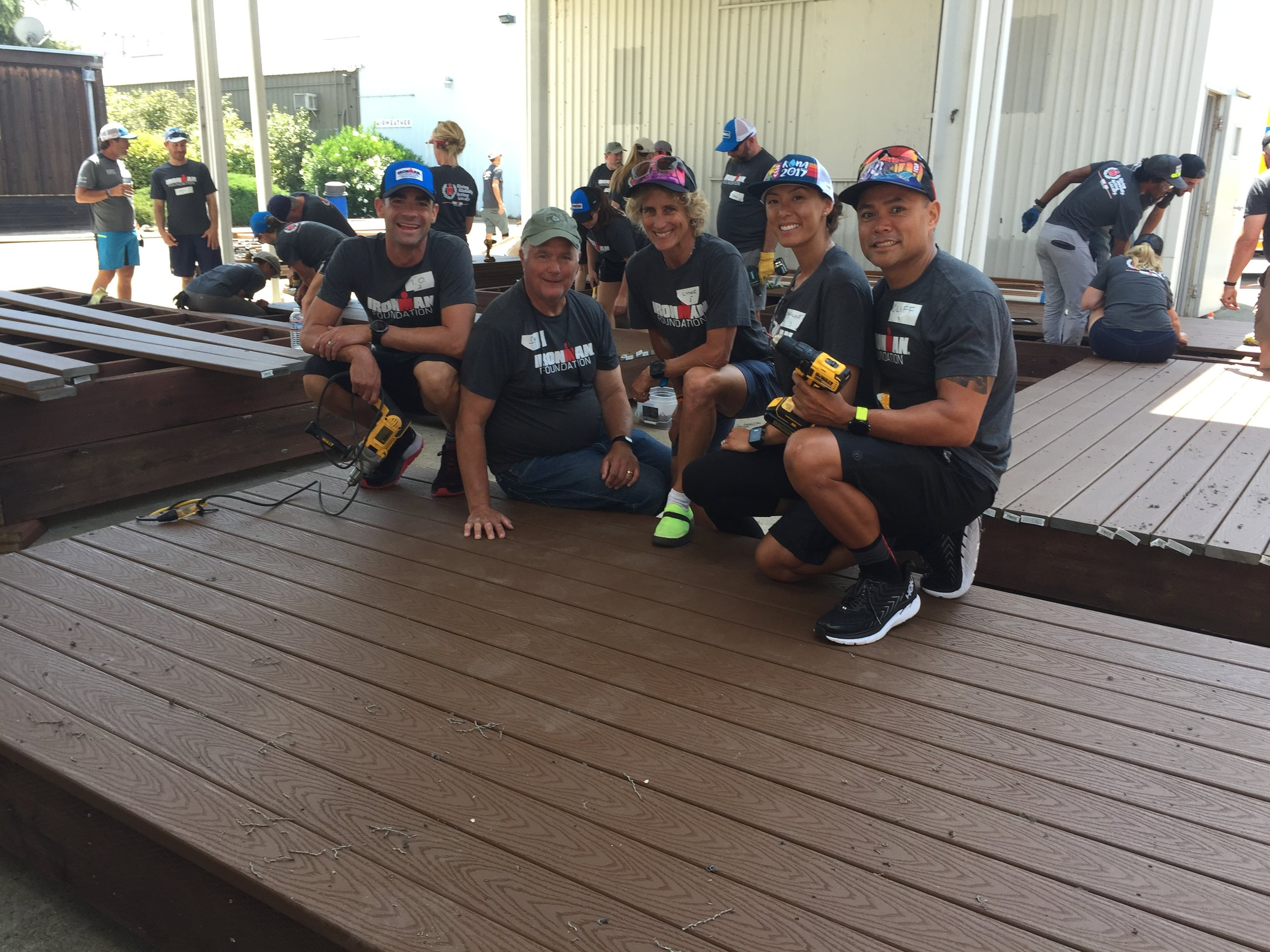 A crew of IRONMAN Foundation volunteers poses with their first finished deck!