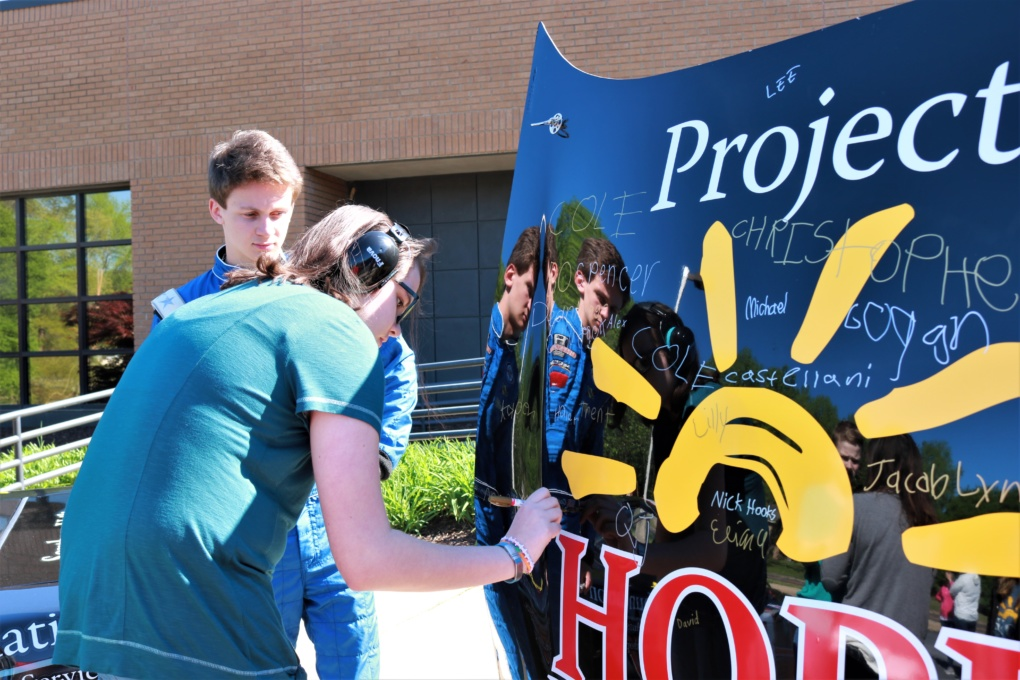 Project HOPE students and young adults signed the hood of Howard's racecar. Photo provided.