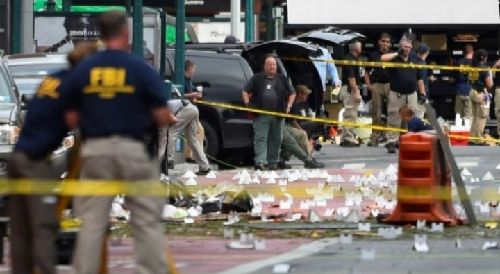 FBI officials stand amid site of explosion in New York. (REUTERS/Rashid Umar Abbasi)