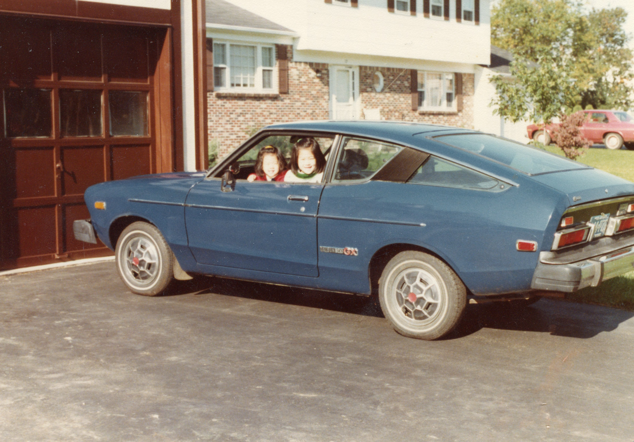 My sister and I playing in the family Datsun.