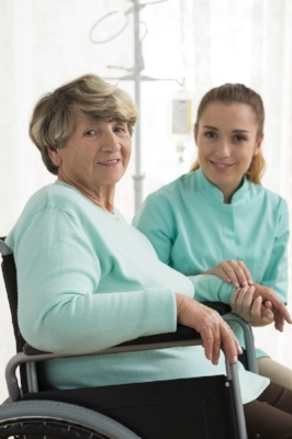 Smiling disabled woman and nurse in care home-1.jpeg