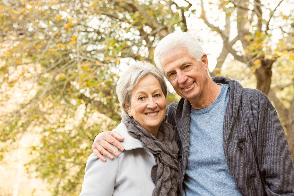 Senior couple in the park on an autumns day.jpeg