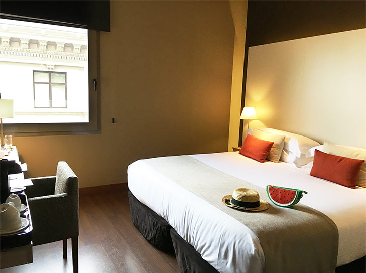 Our comfy King size bed with the view of Gothic Quarter.