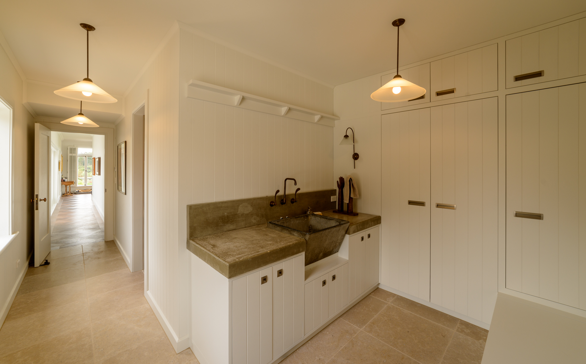 The 'mud room' features a recycled concrete tub, with recycled taps, set into a cast in-situ bench top.