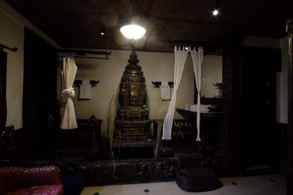 Bathroom and shower, and Bayon faces, and pond