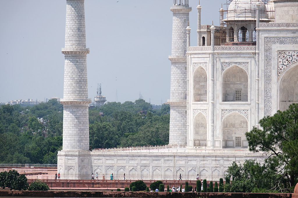Those are people walking along the base of the Taj Mahal, i.e. it is big!