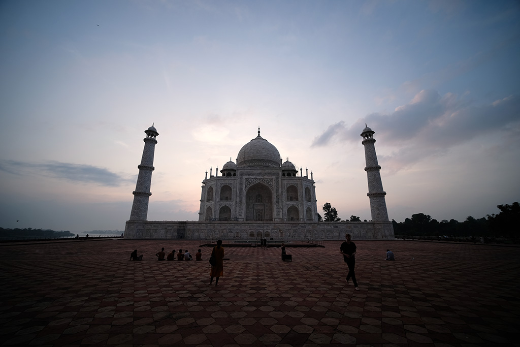 The sky lightening behind the Taj Mahal