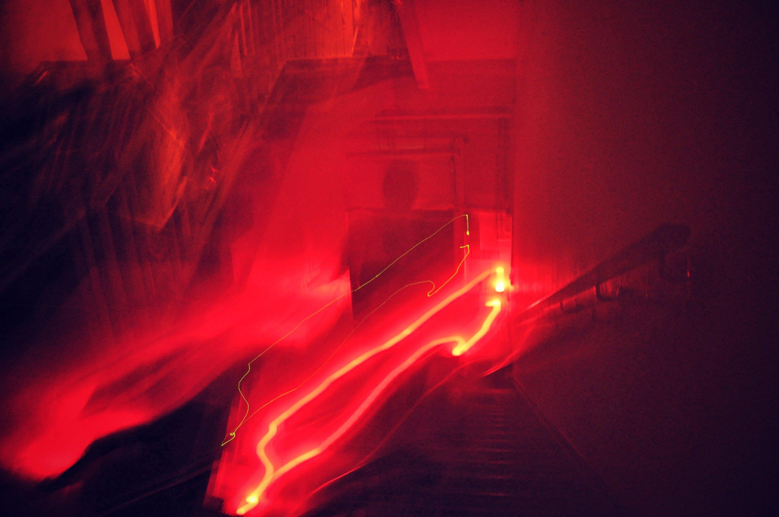 Still from Artist Charlie Murphy's 'Safe Light' performance at Tempting Failure festival.