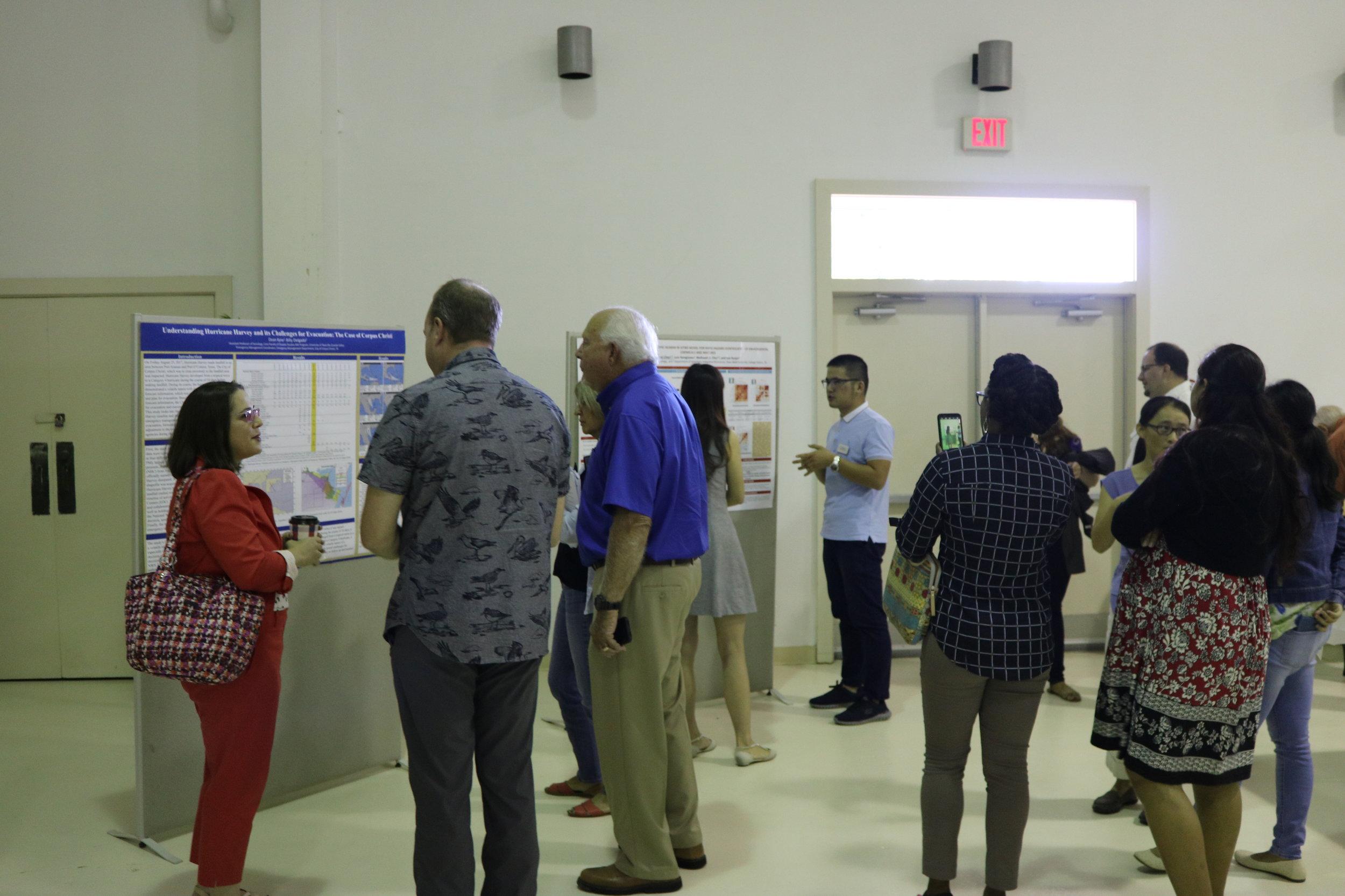 Mayor Charles R. Bujan reading the presentation poster...