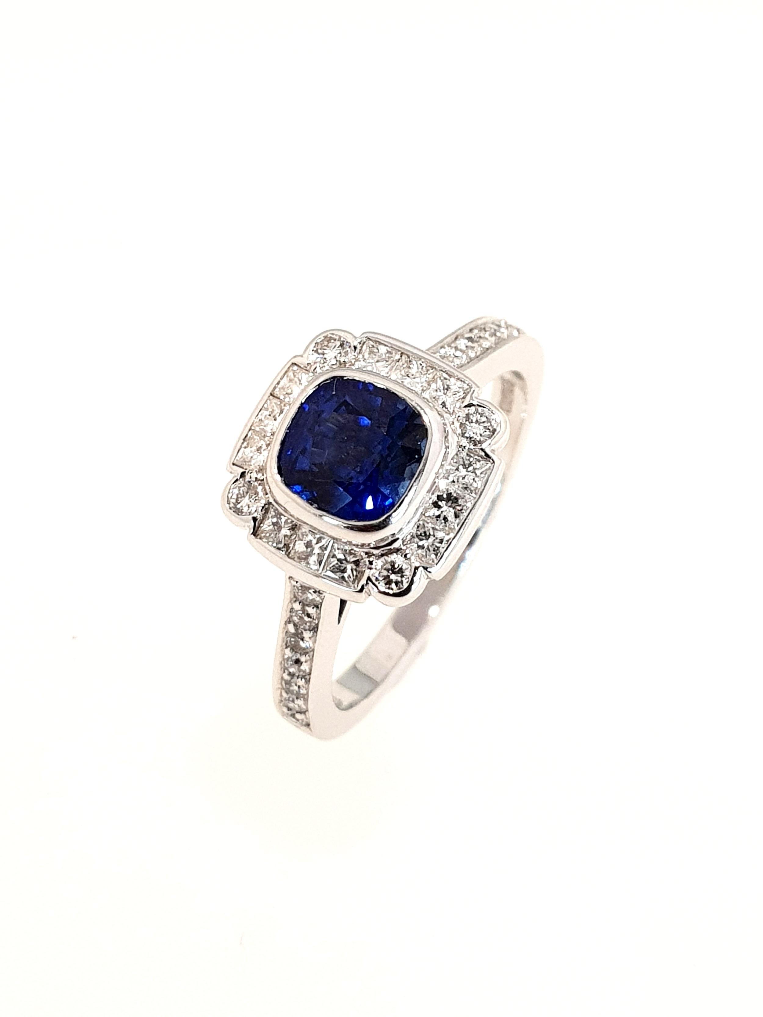 18ct White Gold Sapphire(.24ct) & Diamond Ring  Diamond: .29ct, G, Si1  Stock Code: N8944  £5500