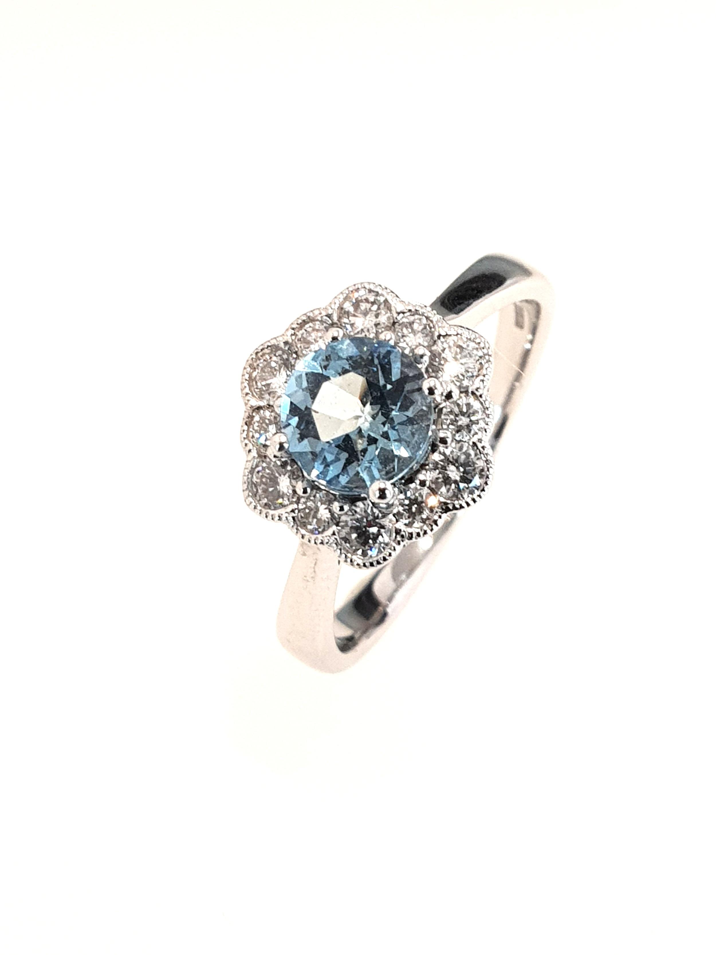 18ct White Gold Aquamarine(.67ct) & Diamond Ring  Diamond: .20ct, G, Si1  Stock Code: N8948  £1650