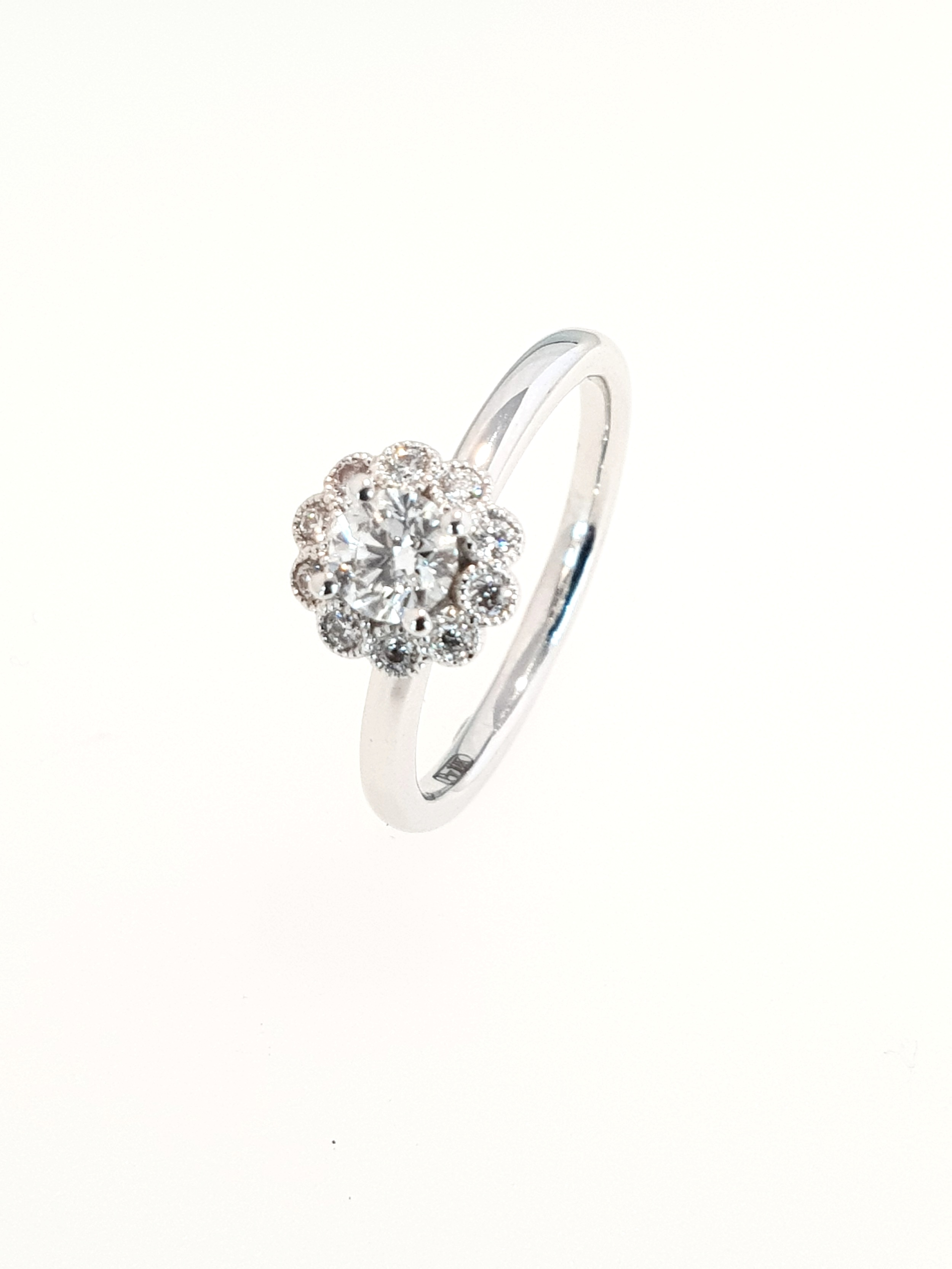 18ct White Gold Diamond Halo Ring  Centre: .40ct, G, SI1 & 10 x .10ct Halo  Stock Code: N8834  £1800