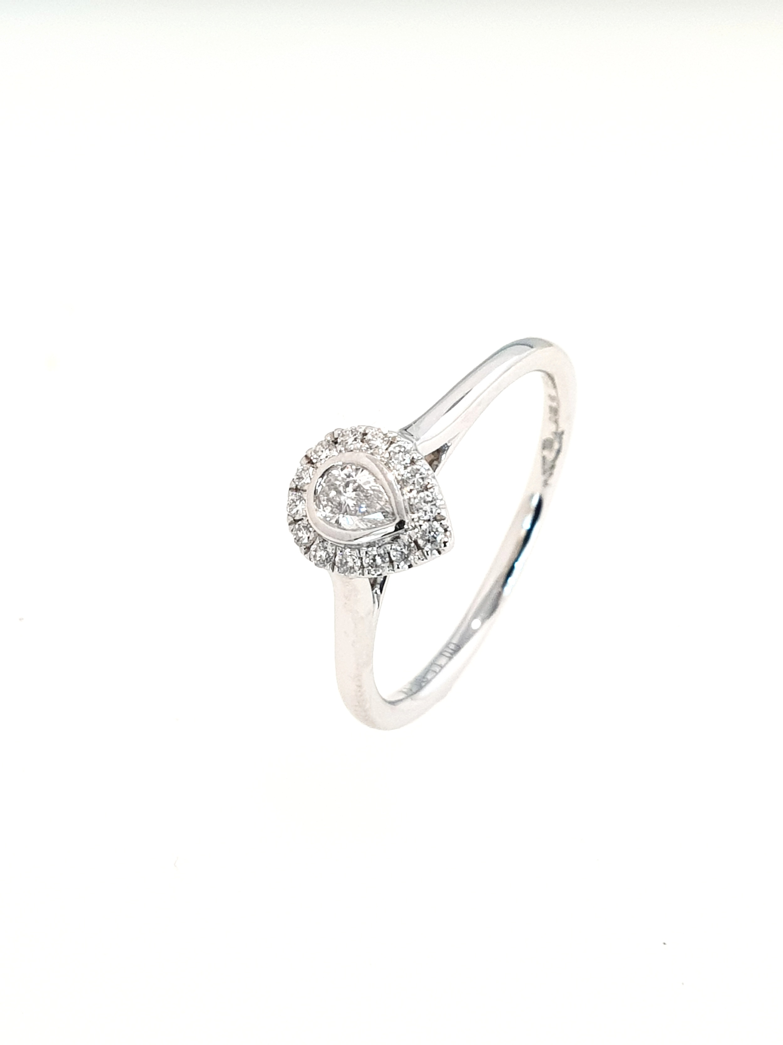 Platinum Pear Shaped Diamond Halo Ring  G, Si1  Stock Code: N8941  £1550