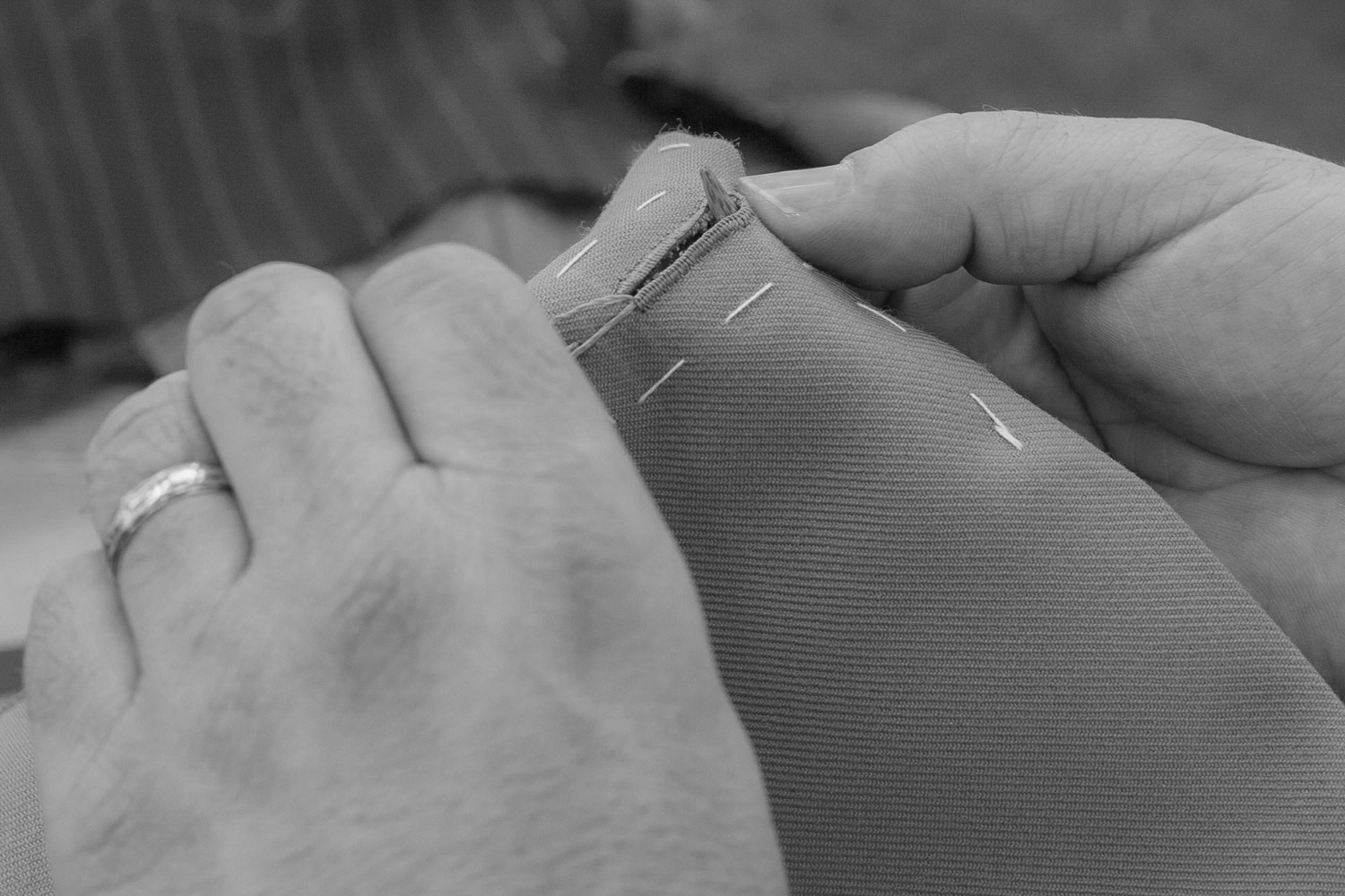 Hand stitch button holes Paul Henry Tailoring.jpg