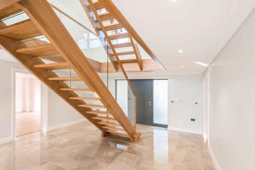 Double height entrance hall with Smet staircase
