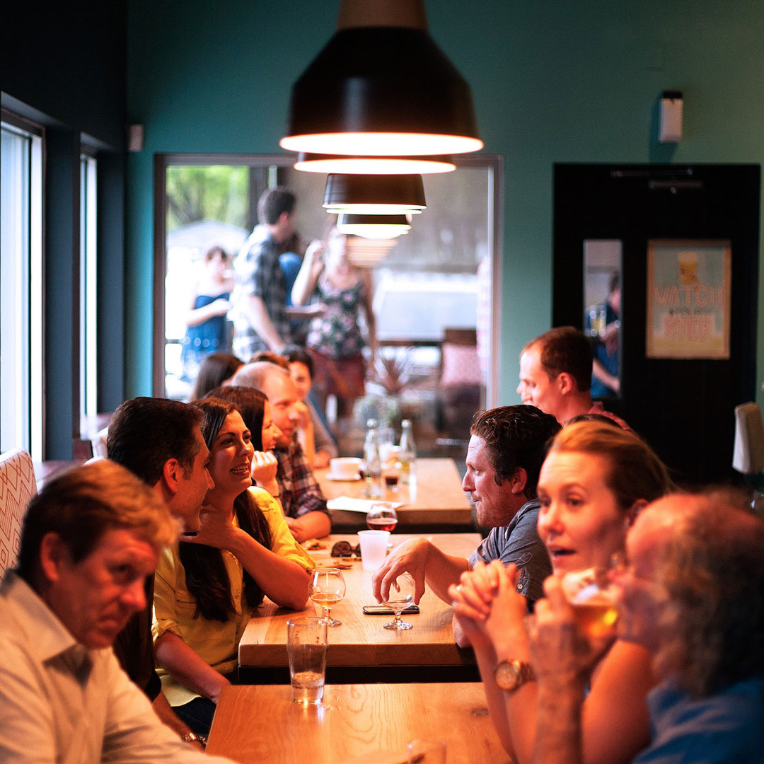 Participating in company happy hours and hosting business meetings at bars can boost your career.