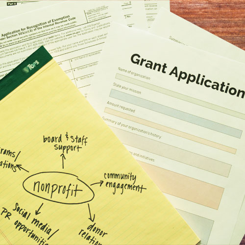 Grant application, nonprofit flow chart, and 501(c)(3) IRS paperwork.