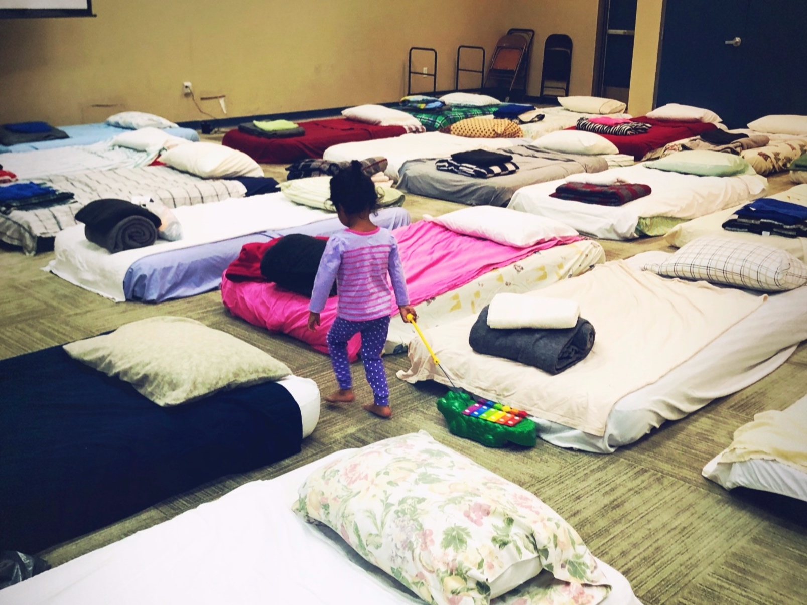 Young asylum seeker gets ready for rest after her long journey.   All photo credits: Laurie Smith Photography