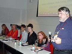 Don Frew moderating a panel at the 2009 Parliament of the World's Religions.