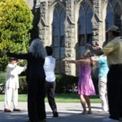 Master Lin Yi Wu leads beginners in the rudiments of Tai Chi.