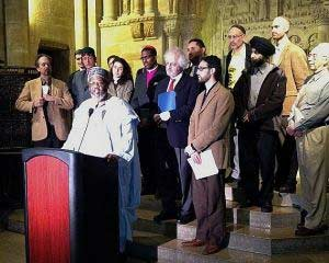 Rabbi Justus Baird, top row, far right, joins clergy from various faiths to protest the profiling and surveillance of Muslims by the NYPD earlier this year.