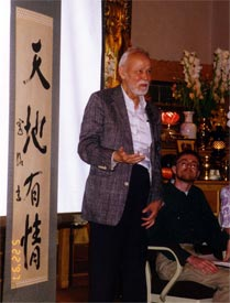 """Professor Smith at the Berkeley Buddhist Monastery in 2001. The banner says """"Heaven and Earth Are Sentient."""""""