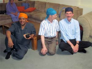 Interfaith collaboration means finding yourself in unlikely settings with friends from around the world. Here Mussie Hailu, l., Africa's Golden Rule Ambassador, Paul McKenna, creator of the Golden Rule poster, and Sam Muyskens, executive director of Inter-Faith Ministries of Wichita, Kansas, sit together in Sikh head-scarves following a prayer service in Phoenix, Arizona.