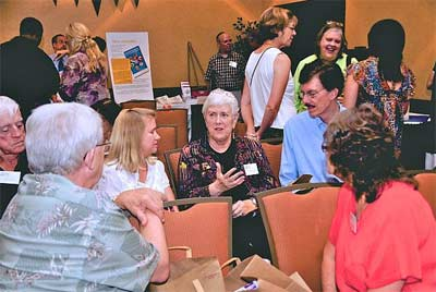 Jan Swanson, with her hand up, talks with trustees at the Phoenix 2011 Connect about bringing NAIN to Atlanta in 2012.