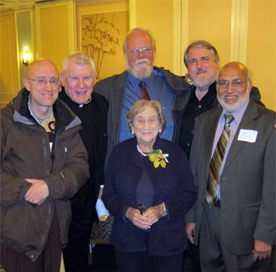 Five friends and interfaith colleagues surround Rita at her birthday celebration. From left, Rev. Heng Sure (Buddhist), Father Gerry O'Rourke (Catholic), Paul Andrews (Episcopalian), Elder Don Frew (Wiccan), and Iftekhar Hai (Muslim). All six have served as Interfaith Center at the Presidio trustees and as trustees or executive staff of United Religions Initiative.