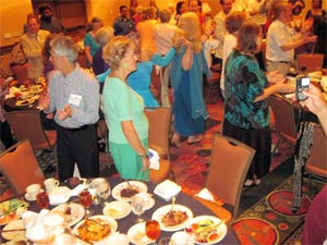 Good food, singing, and even a line-dance, caught at this North American Interfaith Network dinner, enhances hospitality, a sense of connectedness, and the friendly relations that nurture healthy interfaith relationships.
