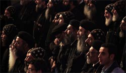 Coptic clergymen at a ceremony for choosing a pope.   Story  . Photo: Tara Todras-Whitehill for   The New York Times  .
