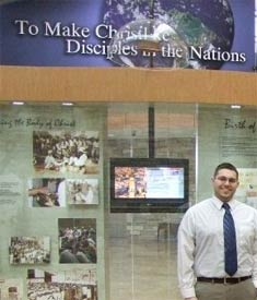 Andrew standing in front of the Nazarene Global Ministry Center